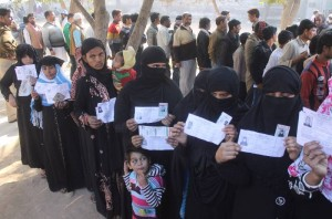 Muslim women stand in a queue to cast their vote in the first phase of the Uttar Pradesh assembly elections in Mathura (Photo: IANS)