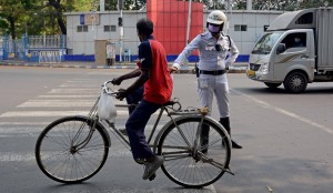 Kolkata: Police personnel intercept violaters during a complete lockdown for 21 days announced by Prime Minister Narendra Modi to prevent further spreading of the COVID 19 pandemic in India; in Kolkata on March 25, 2020. (Photo: Kuntal Chakrabarty/IANS)