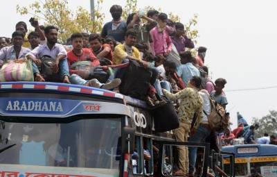 Kolkata: An overcrowded bus with migrant workers returning back home amid COVID-19 outbreak, seen during complete lockdown in the country in a bid to curtail the spread of coronavirus, in Kolkata on March 23, 2020. (Photo: Kuntal Chakrabarty/IANS)