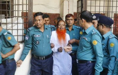 Dhaka: Police escort a member of a banned terror outfit Jamaat-ul-Mujahideen Bangladesh after he was sentenced to death for an attack on a Dhaka's Holey Artisan Bakery that killed more than 20 people in Dhaka, Bangladesh on Nov 27, 2019. (Photo: bdnews24/IANS)