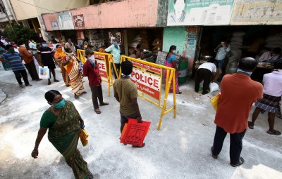 Chennai: People queue up to collect foodgrains at a ration shop during the 21-day nationwide lockdown (that entered the 10th day) imposed as a precautionary measure to contain the spread of coronavirus, in Chennai on Apr 3, 2020. The Tamil Nadu Government had announced Rs 1000 assistance for all ration cardholders in the state from April 2 to 13. (Photo: IANS)