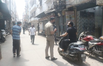 New Delhi: A police personnel intercepts a commuter during complete lockdown imposed in 560 districts in 32 states and union territories across the country, as precautionary measures to contain the spread of the coronavirus, in New Delhi on March 24, 2020. (Photo: IANS)