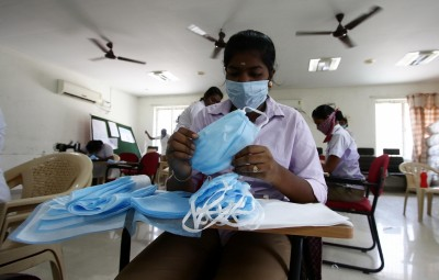 Chennai: A unit member of the police team busy manufacturing masks for police personnel amid COVID-19 pandemic during the 21-day nationwide lockdown (that entered the 8th day) imposed as a precautionary measure to contain the spread of COVID-19 (coronavirus), in Chennai on Apr 1, 2020. (Photo: IANS)