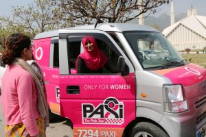 (180308) -- ISLAMABAD, March 8, 2018 (Xinhua) -- A female driver talks with a customer during a launching ceremony of the women-only Pink Taxi in Islamabad, capital of Pakistan, on March 8, 2018. A taxi service only for women was launched in Islamabad to celebrate the International Women's Day. (Xinhua/Ahmad Kamal) (zy)